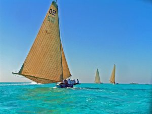 Tom sailing on a Bahamian A Class Sloop Courageous during races at Staniel Cay.